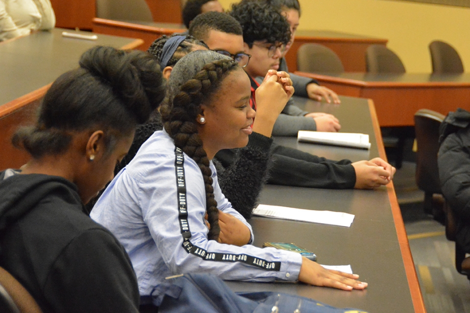 High school students listen to a panel lecture at GW Law.