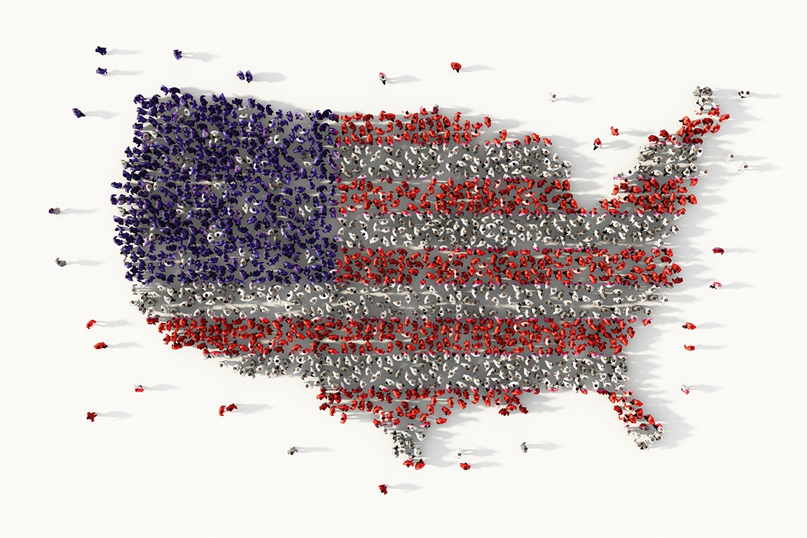 A large group of people moving together in red, white, and blue to form a shape of the United States.
