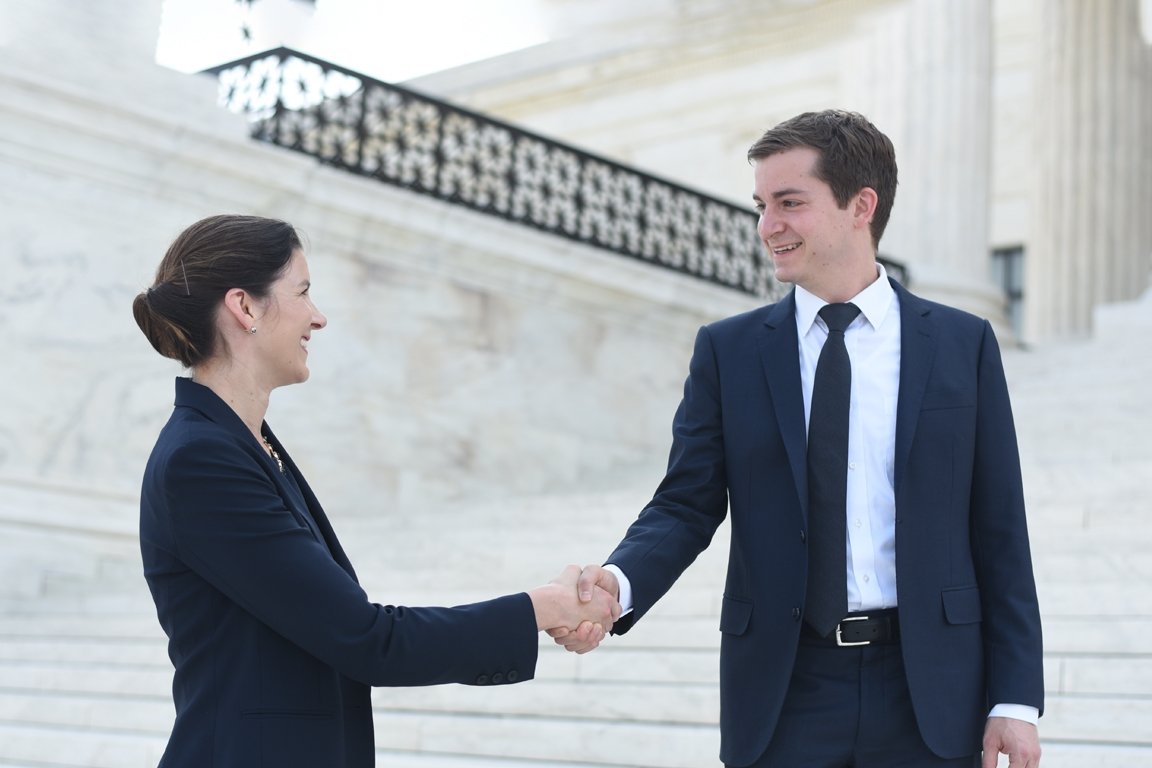 Students Shaking Hands on Supreme Court Steps