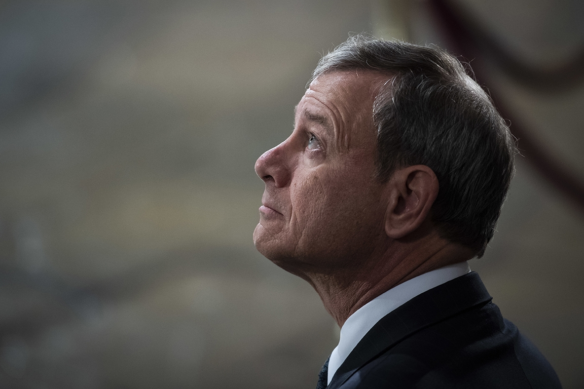 Supreme Court Chief Justice John Roberts looks up to the sky.