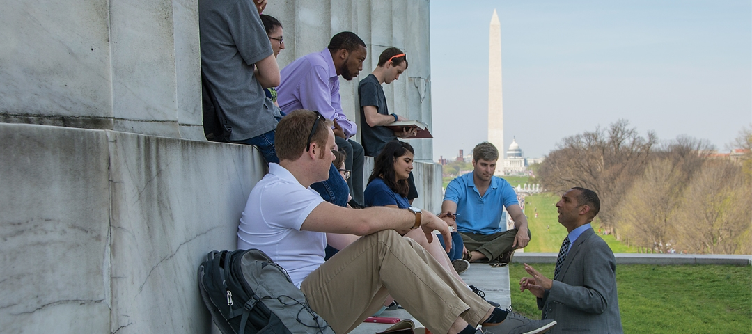 Spencer Overton teaches students at the Lincoln Memorial.