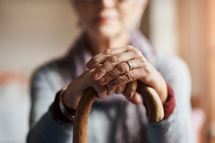 Image of an Elderly Woman Holding a Cane