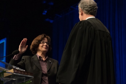 Professor Mary M. Cheh, left, poses with the Honorable Craig S. Iscoe, right, during the swearing-in ceremony.