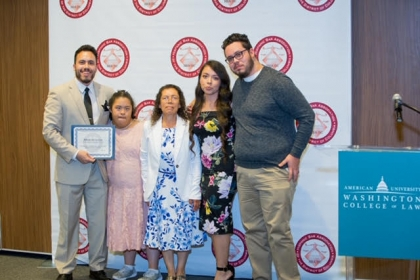 Alfredo De La Cruz stands with his family after being recognized by the Hispanic Bar Association Foundation