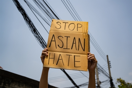Man holding Stop Asian Hate sign