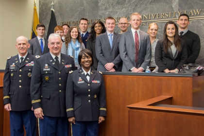 Photo of judges of the U.S. Army Court of Criminal Appeals with GW Law students.