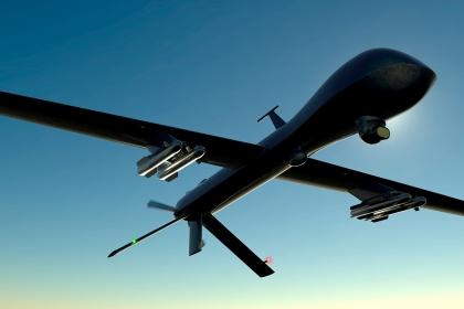 Military drone flying