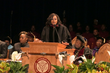GW Law alumna Johanna Leblanc stands behind a podium and speaks to students at Bethune-Cookman University.