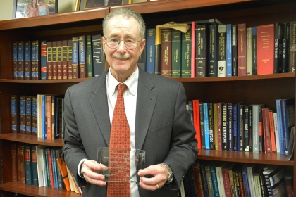 Professor Stephen A. Saltzburg poses with his Trial Lawyer Excellence Award.