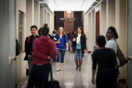 Students walk up a hallway at GW Law.